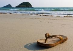 Author: Stoonn / FreeDigitalPhotos.net Source: http://www.freedigitalphotos.net/images/Vacations_g208-Flipflops_On_The_Beach_p42192.html
